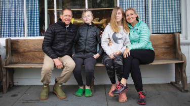 Aimee and Barrett Foster with son George and daughter Elizabeth sit on a bench for a photo in Cape Cod, Mass.