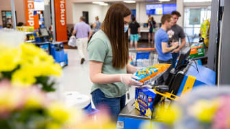 The self-checkout area of a Walmart store.