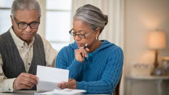 picture of an elderly couple looking over documents