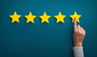Woman pointing to rating system that uses stars
