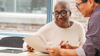 Senior woman reviewing investments with IRA planner