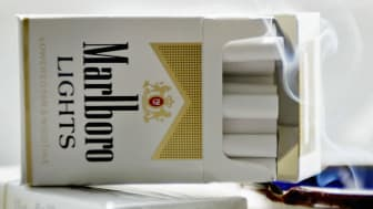 """CHICAGO, IL - APRIL 15:Cigarette maker Phillip Morris USA announced it has started removing the controversial words """"lowered tar and nicotine"""" from packages of Marlboro Lights (it appears on"""