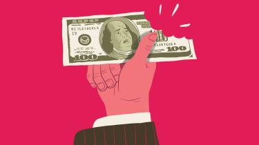 hand holding hundred-dollar bill