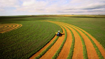 Farmer plowing huge Kansas field