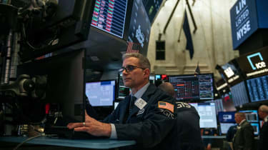NEW YORK, NY - FEBRUARY 28: Traders work on the floor of the New york Stock Exchange on February 28, 2020 in New York City. Markets continued their downward plunge Friday as continuing fears
