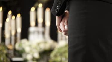 woman at funeral mourning