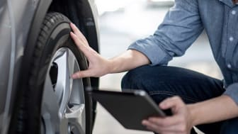 photo of person checking tire