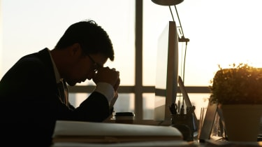Exhausted businessman having moment of rest in office