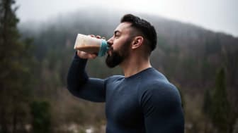 A man drinking a protein shake
