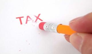 person erasing the word tax