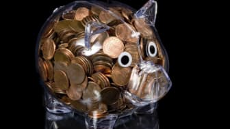 Piggy bank full of coins.