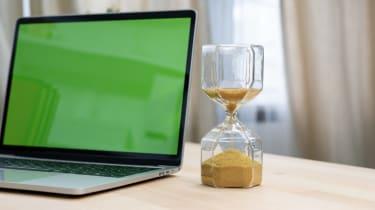 photo illustration of laptop and sandglass