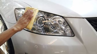 Photo of person cleaning headlights