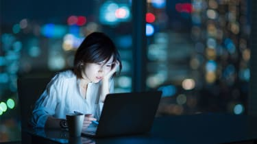 picture of woman working at night