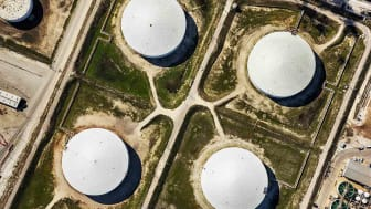 Directly above a group of large oil storage tanks at a refinery in Texas City, Texas, located just south of Houston on Galveston Bay.