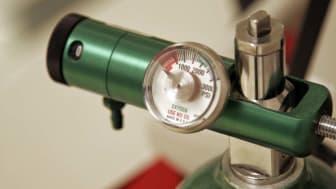 Pressure gauge on an oxygen tank.