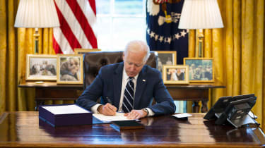 U.S. President Joe Biden participates in a bill signing in the Oval Office of the White House on March 11, 2021, in Washington, D.C.