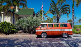 A vintage motor vehicle is parked on the brick paved streets of the historic Old Southeast Neighborhood in Saint Petersburg, Florida.