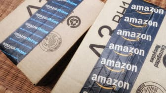 West Palm Beach, USA - June 30, 2016: Amazon packing tape on Amazon.com shipping boxes. One box is taped with Amazon Prime tape and the other has Amazon with the smiling arrow design.