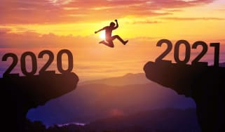 A person jumping from 2020 into 2021