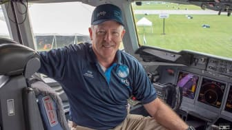 Capt. Gary Dyson sits in the cockpit of an Orbis International jet.