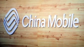 BARCELONA, SPAIN - FEBRUARY 27:A logo sits illuminated outside the China Mobile pavilion during the Mobile World Congress 2017 on the opening day of the event at the Fira Gran Via Complex on