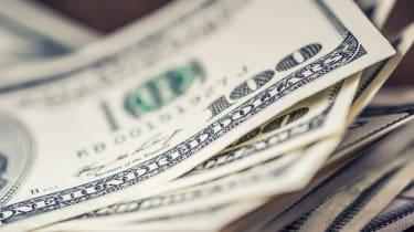 Dollars banknotes closeup. Cash Money American Dollars.Close-up view of stack of US dollars.