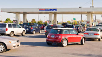 Cars line up waiting to get to the Costco gas pumps