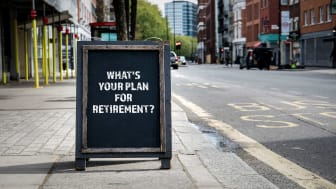 """picture of a sign on a sidewalk saying """"What's Your Plan for Retirement?"""""""