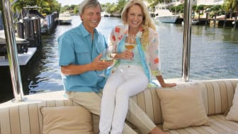 picture of wealthy couple on a boat