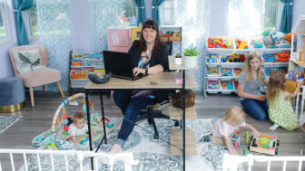 Melanie Martin Ebel photographed with her 4 children in her home office/playroom