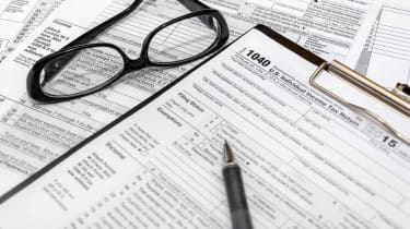 Tax form with pen and glasses