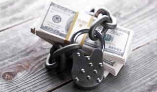 Money locked up in chain with lock. Concept for Secure investing. Savings. Retirement.