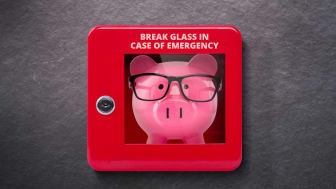 """A piggybank inside of an """"in case of emergency"""" alarm box"""