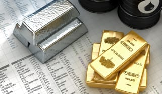 """Silver, gold ingots with oil barrels on fictitious financial datas.Similar images:"""