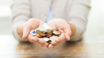 savings, money, annuity insurance, retirement and people concept - close up of senior woman hands holding money jar