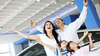 Excited family buying a car