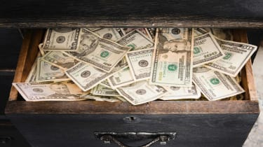 Cash is crammed in a dresser drawer.