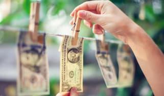 Dollar bills on clothes line