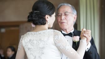A father dancing with his daughter at her wedding