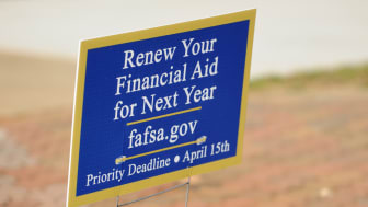 Americus, Georgia, USA - March 13, 2016:Close up of yard sign encouraging students to renew financial aid for next year, with the web site fafsa.gov.Priority deadline of April 15th.Sign place