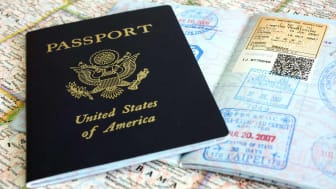 A passport atop some maps