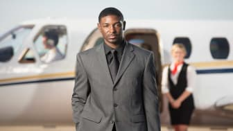 picture of a rich guy next to a private jet