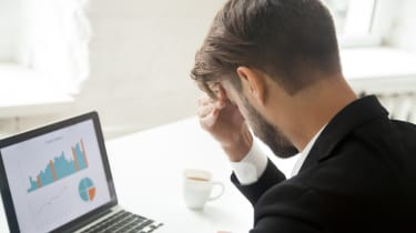 Stressed businessman disappointed with bad financial results, company crisis, falling rates and sales. Depressed entrepreneur frustrated with business loss, debt and market competition. Back
