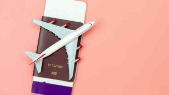 Concept art showing a toy airplane sitting on top of a passport.