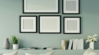 Empty photo frames on a wall.