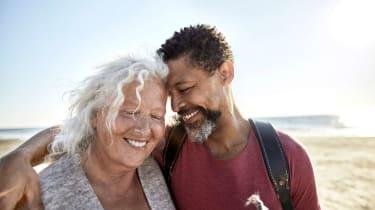 photo illustration of retiree couple on beach