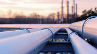 steel long pipe system in crude oil factory during sunset