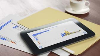A tablet computer shows bar graphs of a portfolio