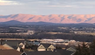 The Blue Ridge mountains in the distance from a residential neighborhood in Staunton, Va.